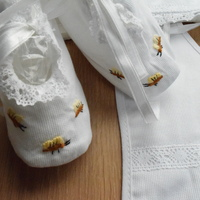 Baby set with baby shoes, baby bib and bonnet