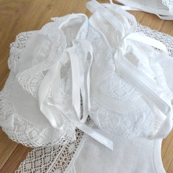Baby set with baby shoes and baby bib